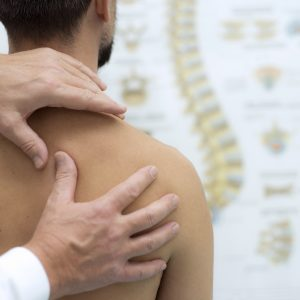 Medical check at the shoulder in a physiotherapy center