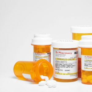 Prescription pills in plastic medicine bottles.
